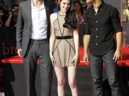 184952-actors-robert-pattinson-l-kristen-stewart-and-taylor-lautner-put-their