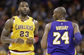 Cleveland Cavaliers' LeBron James (23) and Los Angeles Lakers' Kobe Bryant (24) talk in the second half of an NBA basketball game Wednesday, Feb. 10, 2016, in Cleveland. (AP Photo/Tony Dejak) ORG XMIT: OHTD10