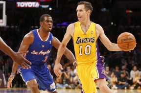 Los Angeles Lakers' Steve Nash, right, passes off the ball as Los Angeles Clippers' Chris Pauldefends during the first half of an NBA basketball game in Los Angeles, Tuesday, Oct. 29, 2013. (AP Photo/Danny Moloshok)